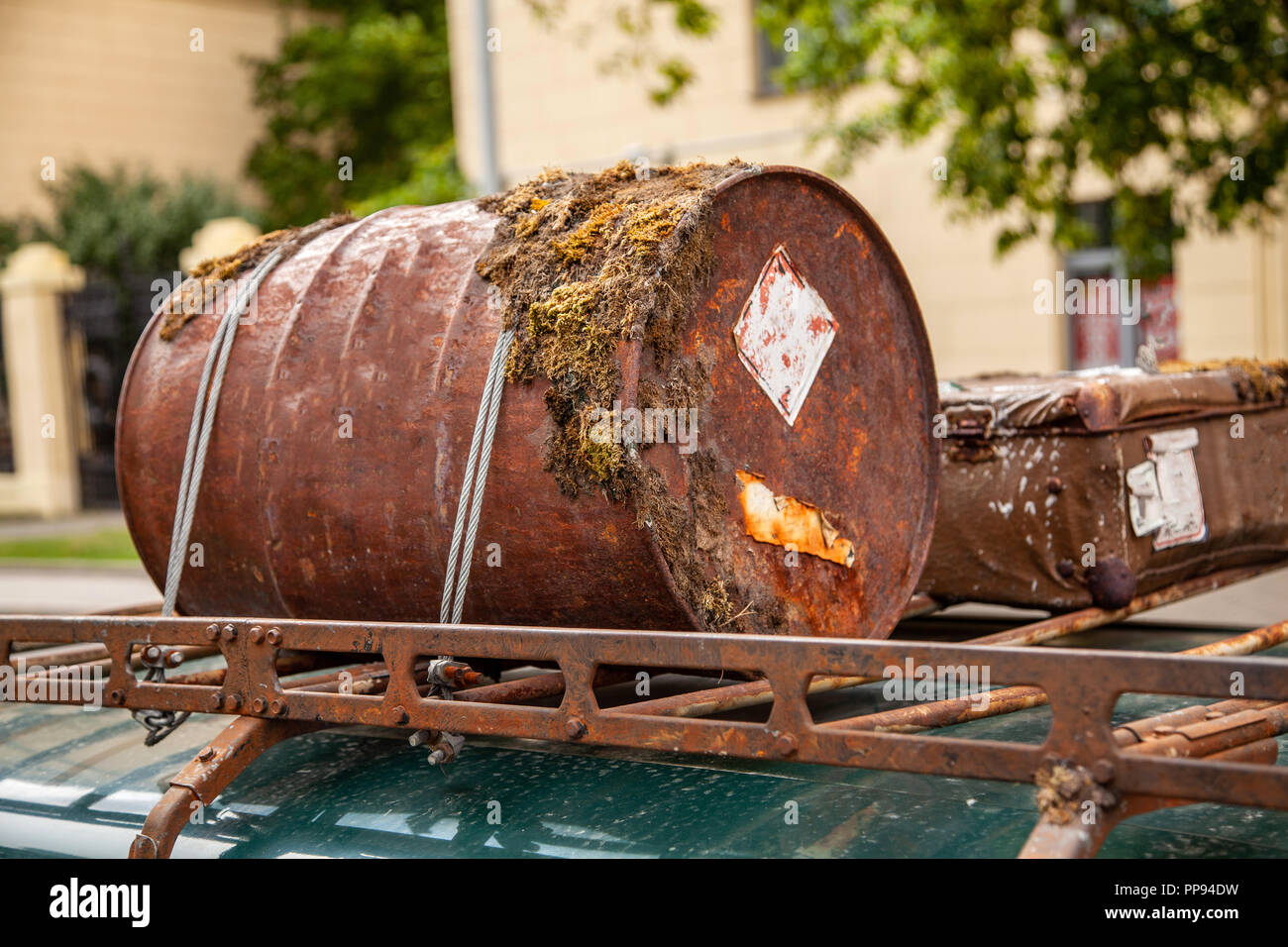 Rusted barrel in the trunk of the car Stock Photo
