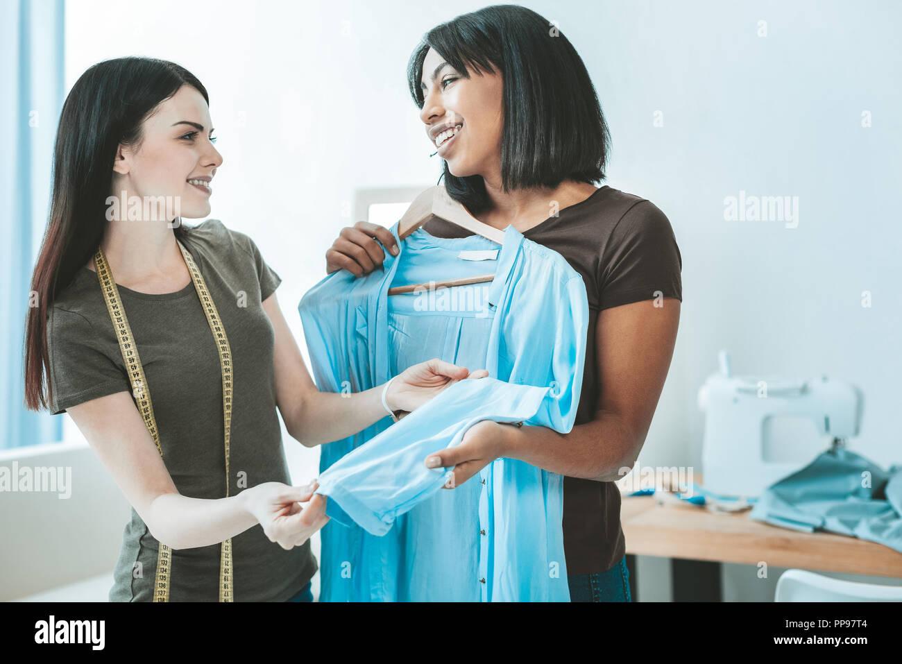 Amazing brunettes having friendly talk - Stock Image