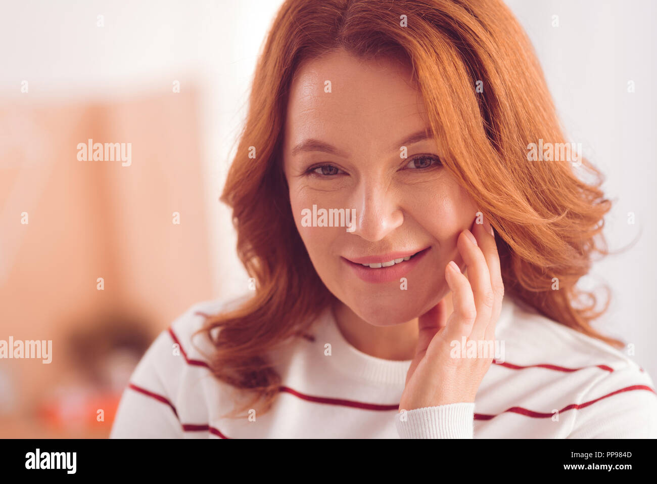 Pleasant woman expressing positive emotions - Stock Image