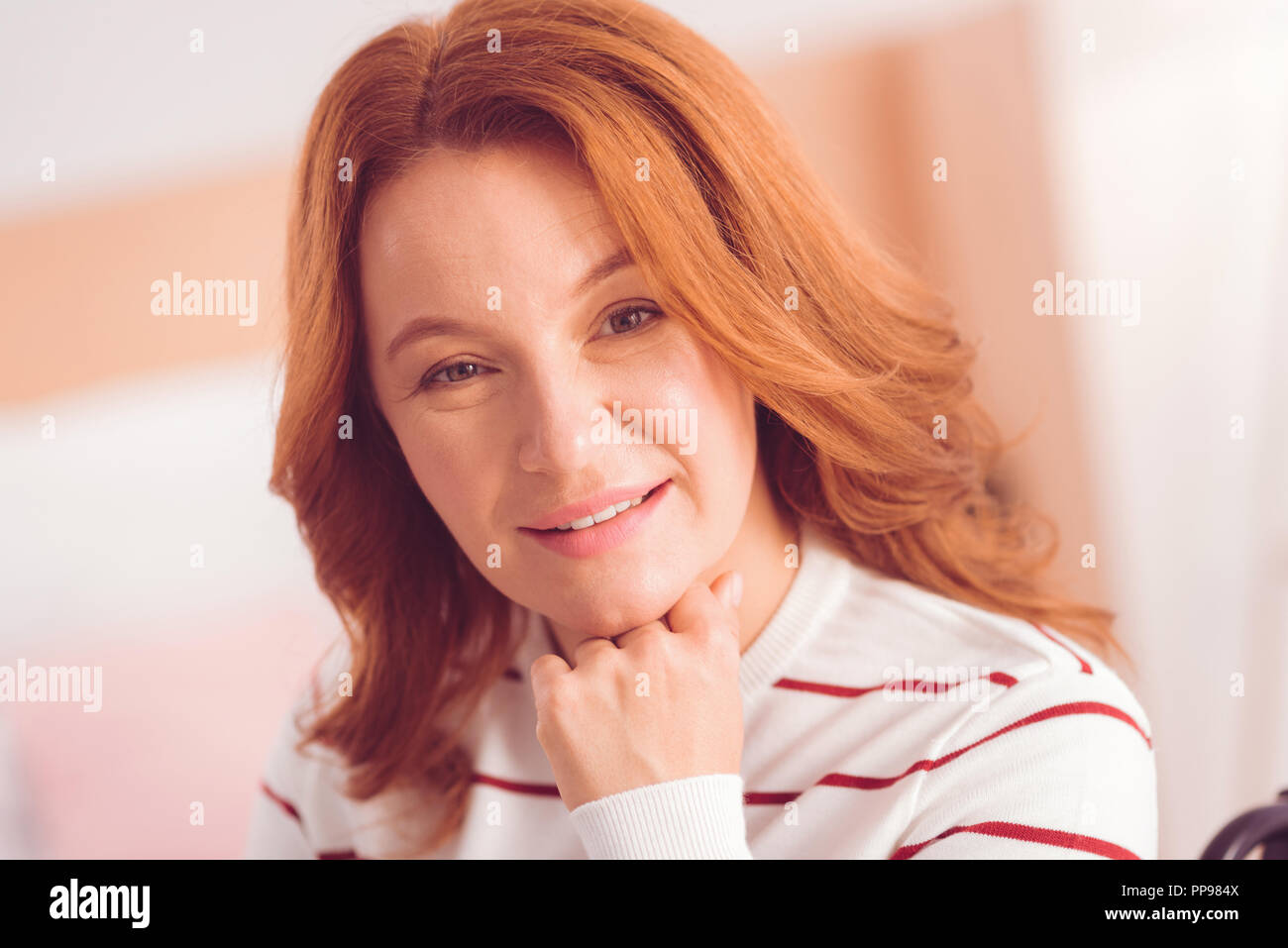 Portrait of a positive woman expressing happiness - Stock Image