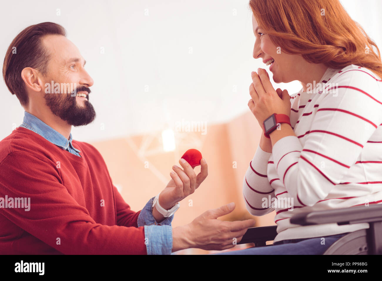 Happy loving man making a proposal - Stock Image