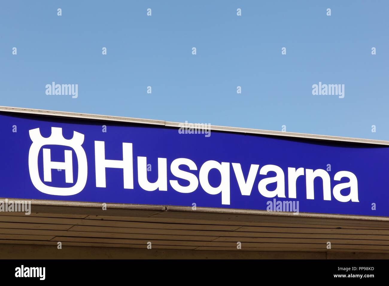 Odder, Denmark - March 30, 2018: Husqvarna logo on a facade. Husqvarna is swedish a manufacturer of robotic mowers, garden tractors, chainsaws - Stock Image
