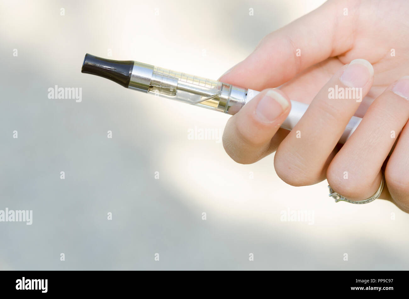 hand holding an electronic cigarette - Stock Image