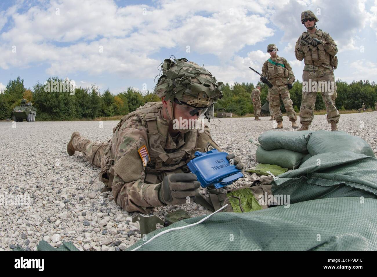 Spc  Jacob Root, 173rd Infantry Brigade Combat Team, inspects a