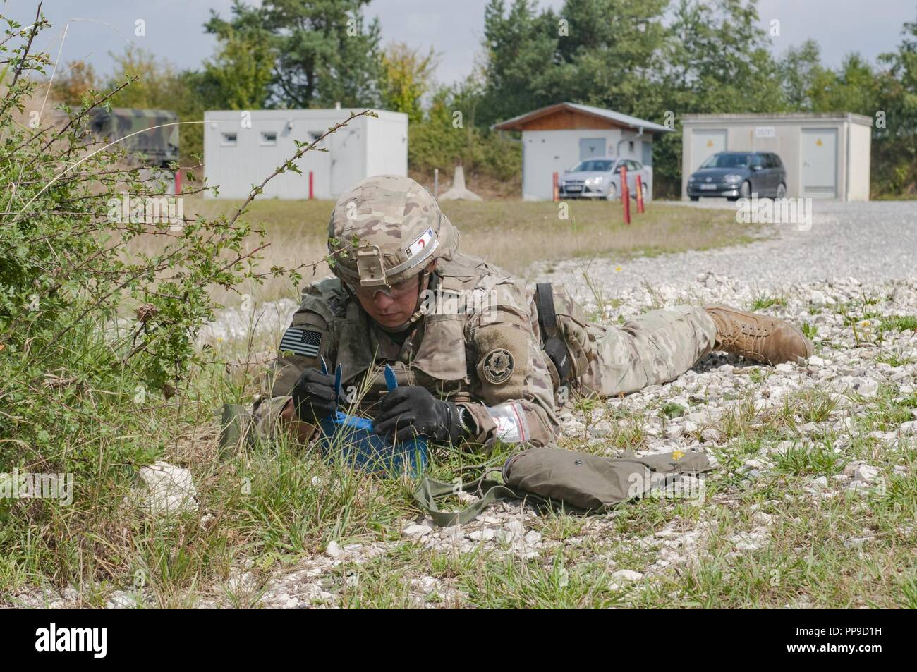 Sgt  Savannah Krekelberg, 2nd Cavalry Regiment, emplaces a M18A1