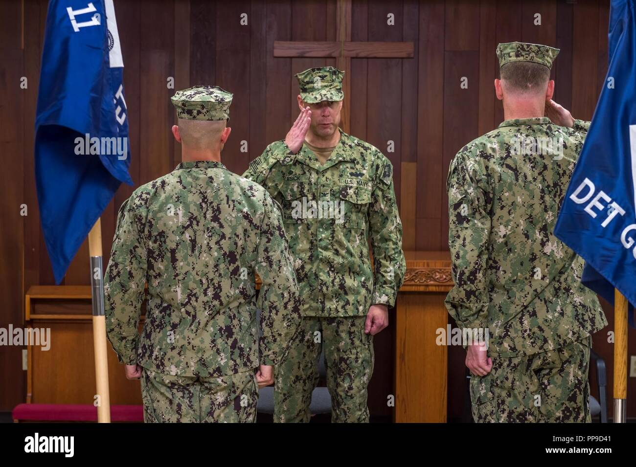 SANTA RITA, Guam (Aug. 15, 2018) Capt. Steven Stasick, commodore 30th Naval Construction Regiment, returns a salute from Lt. Peter Smagur, Naval Mobile Construction Battalion (NMCB) 1, Det. Guam, officer-in-charge, during a relief in place/transfer of authority (RIP/TOA) ceremony. During the ceremony, NMCB 11 Det. Guam was relieved by NMCB 1 Det. Guam. NMCB 11 Det. Guam successfully completed a six-month deployment to Guam, during which they completed many construction projects throughout the Indo-Pacific region. - Stock Image