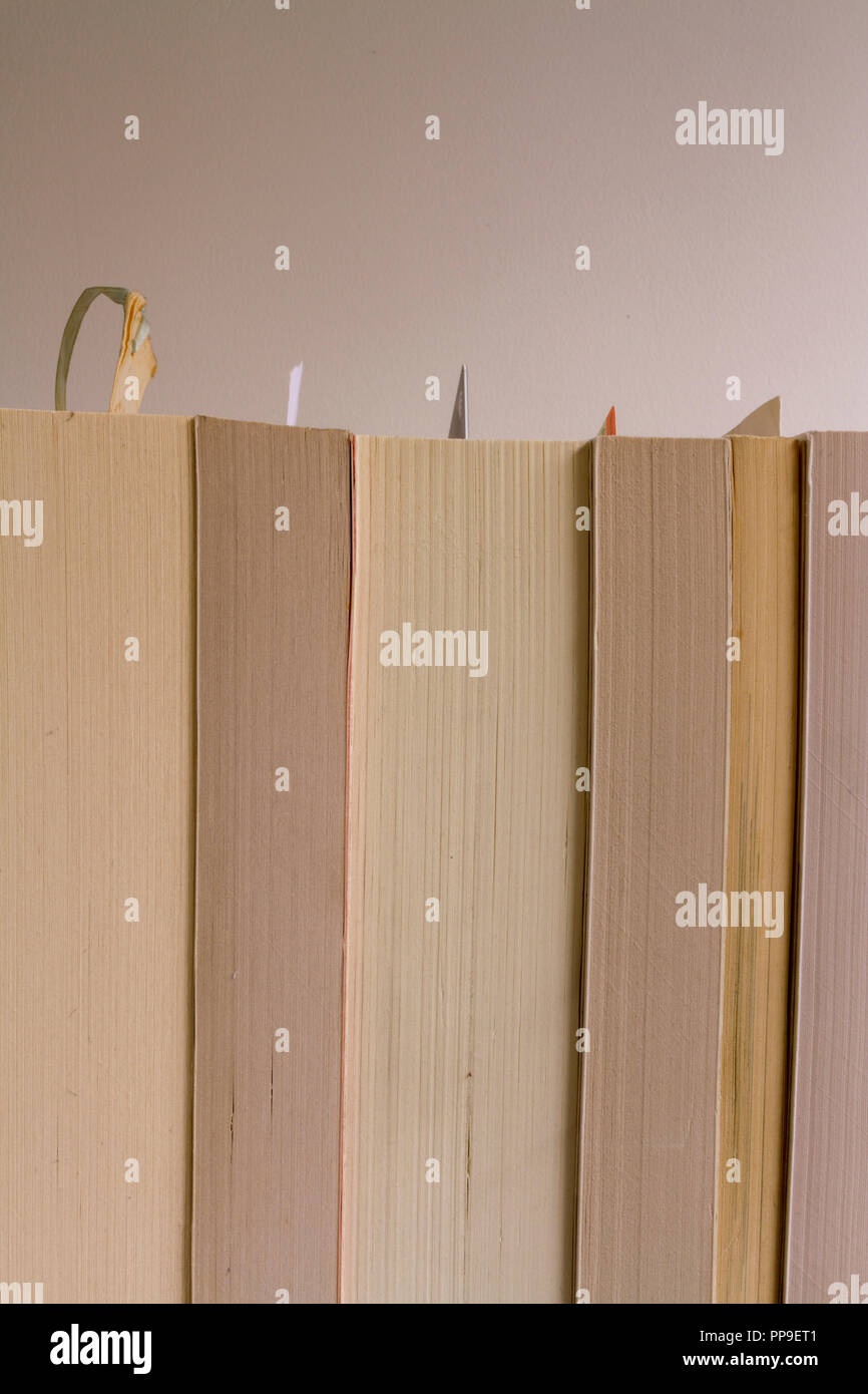 Vertical shot of paperbacks from reverse (spines hidden) with bookmarks. Neutral space for copy in top third - Stock Image