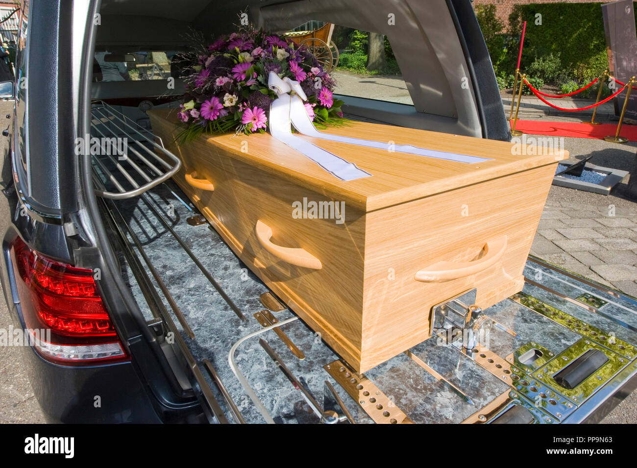 A Coffin With A Flower Arrangement In A Funeral Car Stock Photo