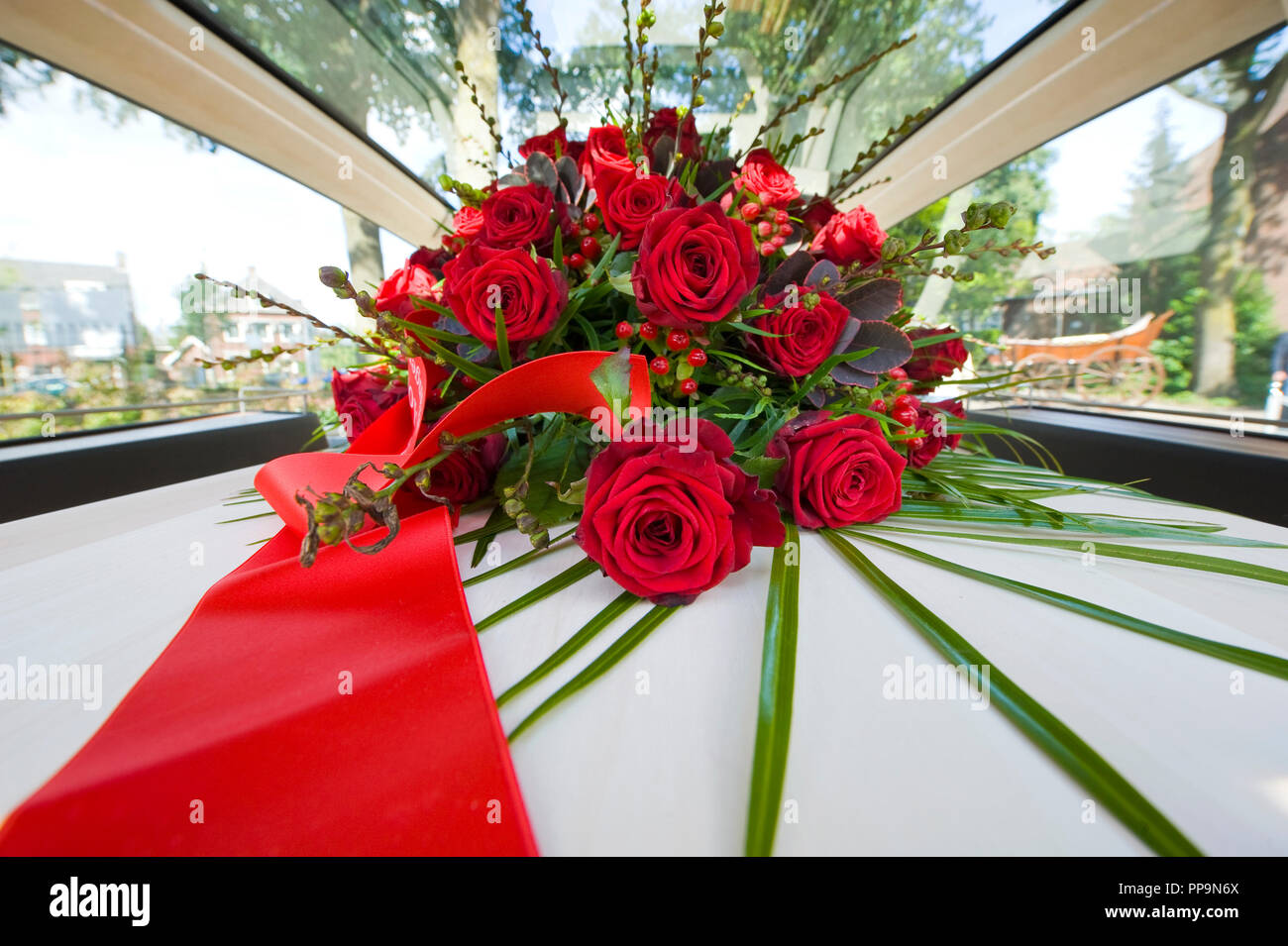 Tomb flower arrangement stock photos tomb flower arrangement stock a coffin with a flower arrangement in a funeral car stock image izmirmasajfo