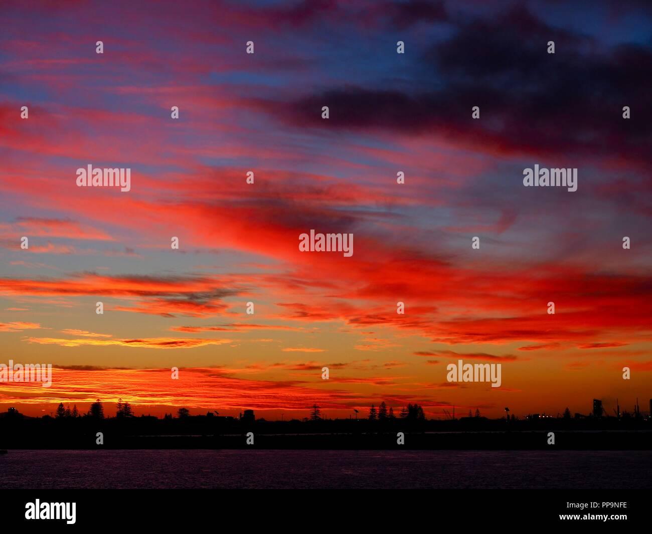 Sunset seen from Nobby's Breakwall, Newcastle NSW - Stock Image
