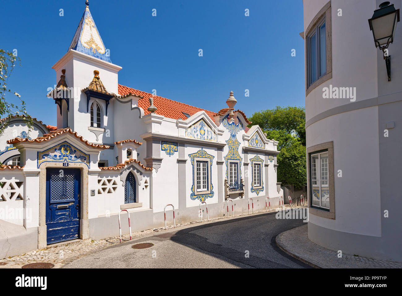 Cascais, Portugal, ancient aristocratic villa with facades decorated with yellow and blue azulejos - Stock Image