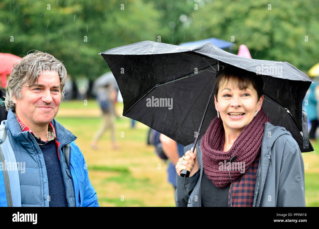 Martin Hughes-Games - BBC nature presenter - and Caroline Lucas MP (Green, Brighton) talking in Hyde Park before the People's Walk for Wildlife, Londo - Stock Image