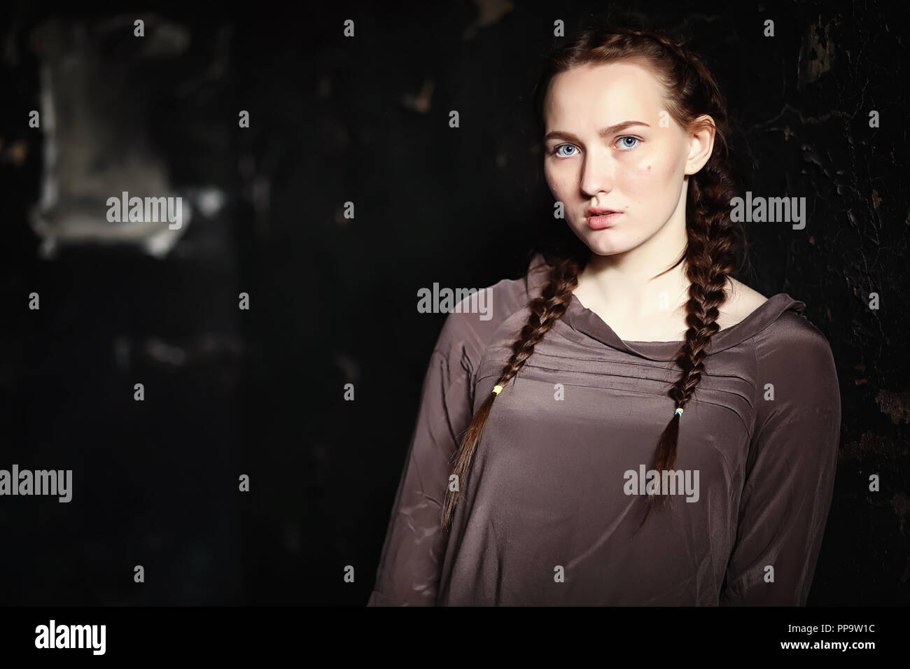portrait of a frightened young pretty girl  - Stock Image