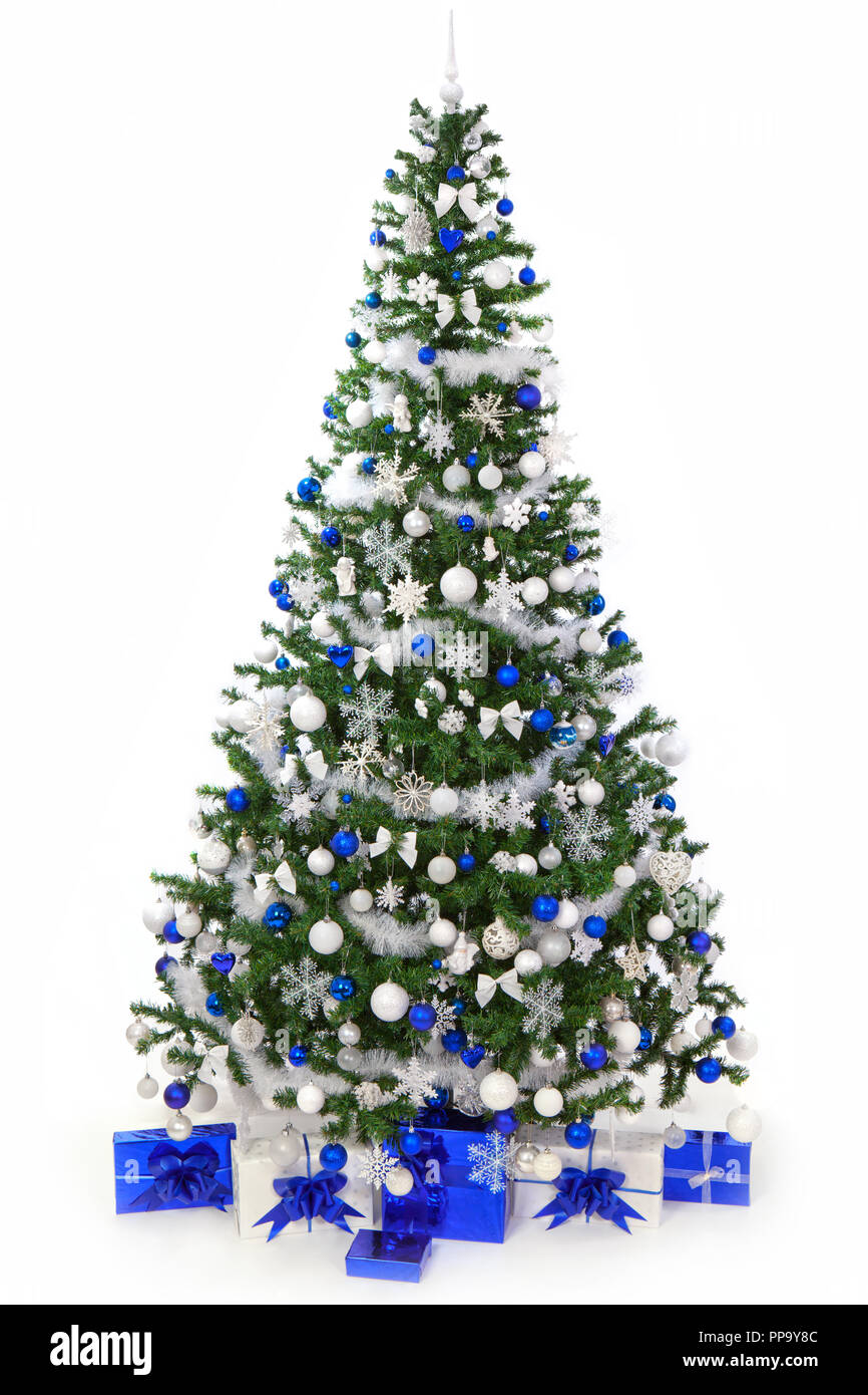 studio shot of a richly decorated christmas tree with blue and white ornaments and blue - Greek Christmas