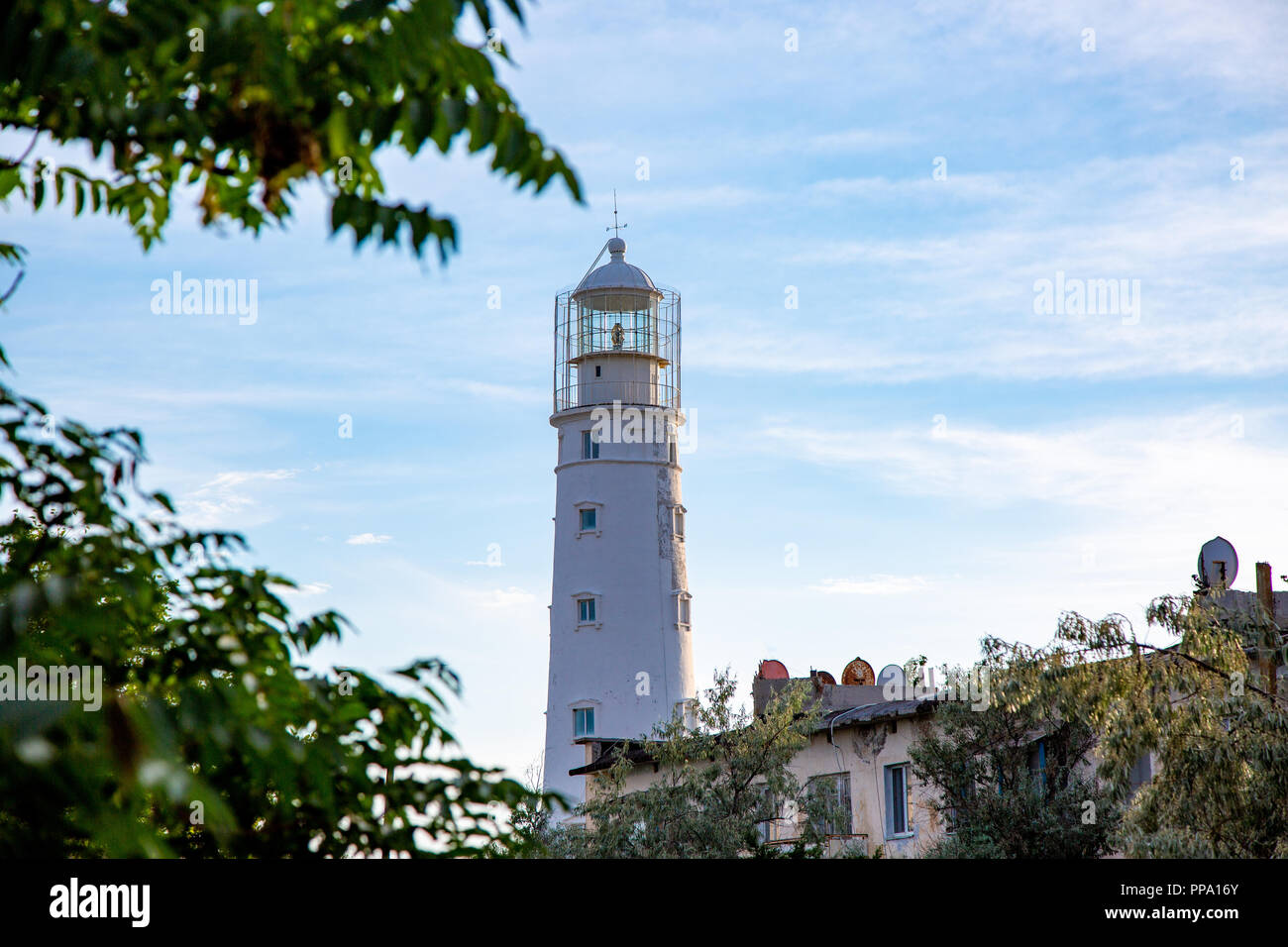 Lighthouse searchlight beam near ocean at day light Lighthouse in clear weather - Stock Image