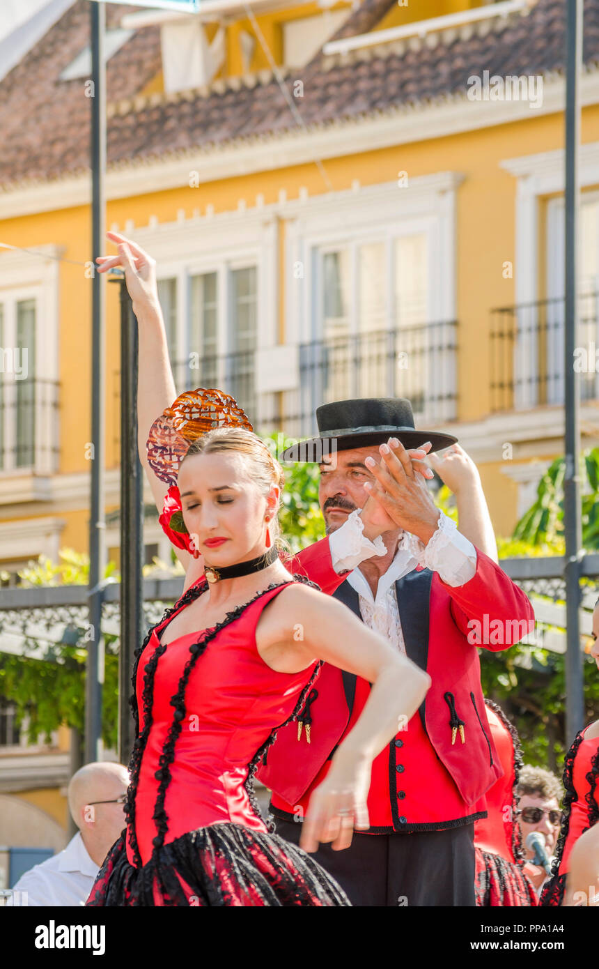 Flamenco dancers, man and woman, performing Fandango, Fuengirola a caballo. Annual event, celebration, event, Málaga, Andalusia, Spain. - Stock Image