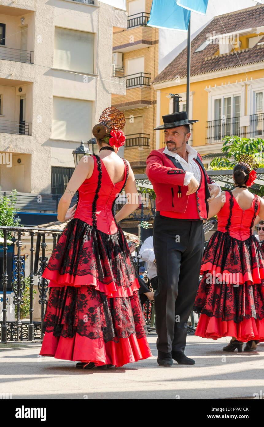 Flamenco dancers, man and woman, performing Fandango, Fuengirola a caballo. Annual event, celebration, event, Málaga, Andalusia, Spain. - Stock Image