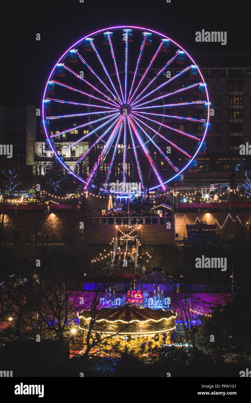 Ferris Wheel at Christmas Market in Edinburgh at night, Scotland UK Stock Photo