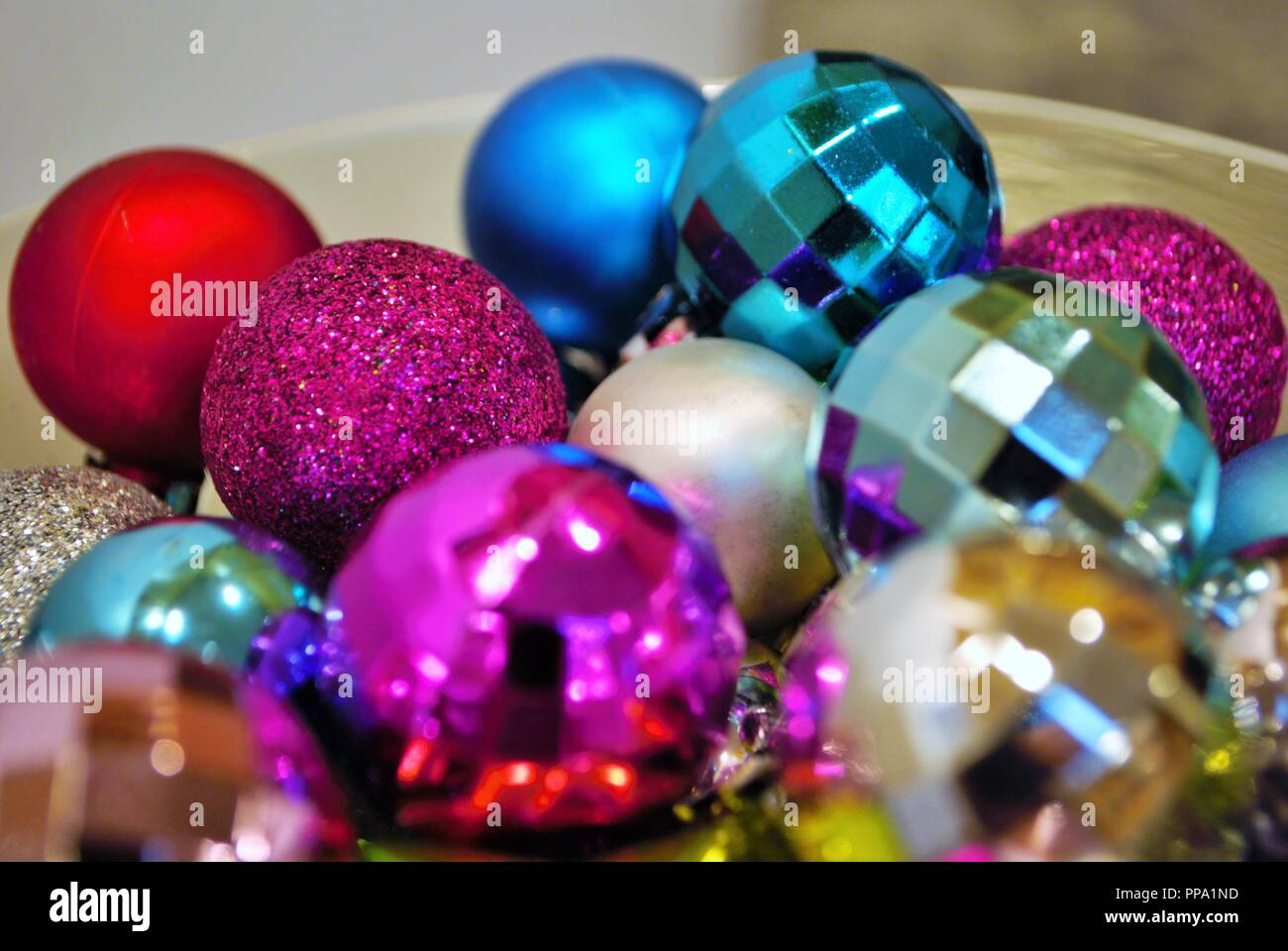 lots of small multicolored christmas ornaments in a decorative bowl - Small Christmas Ornaments