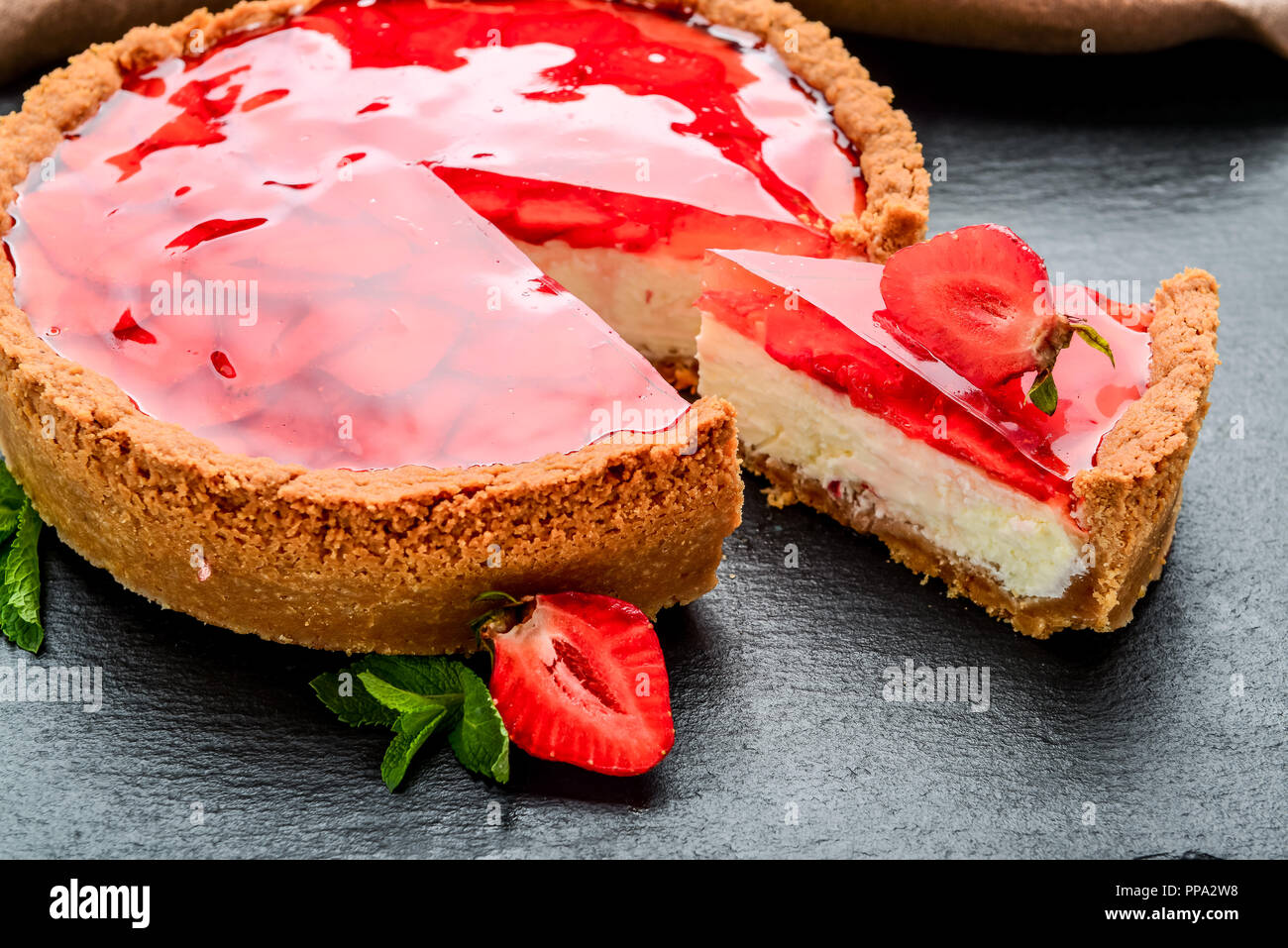 Cold cheesecake with strawberry and strawberry jelly. - Stock Image