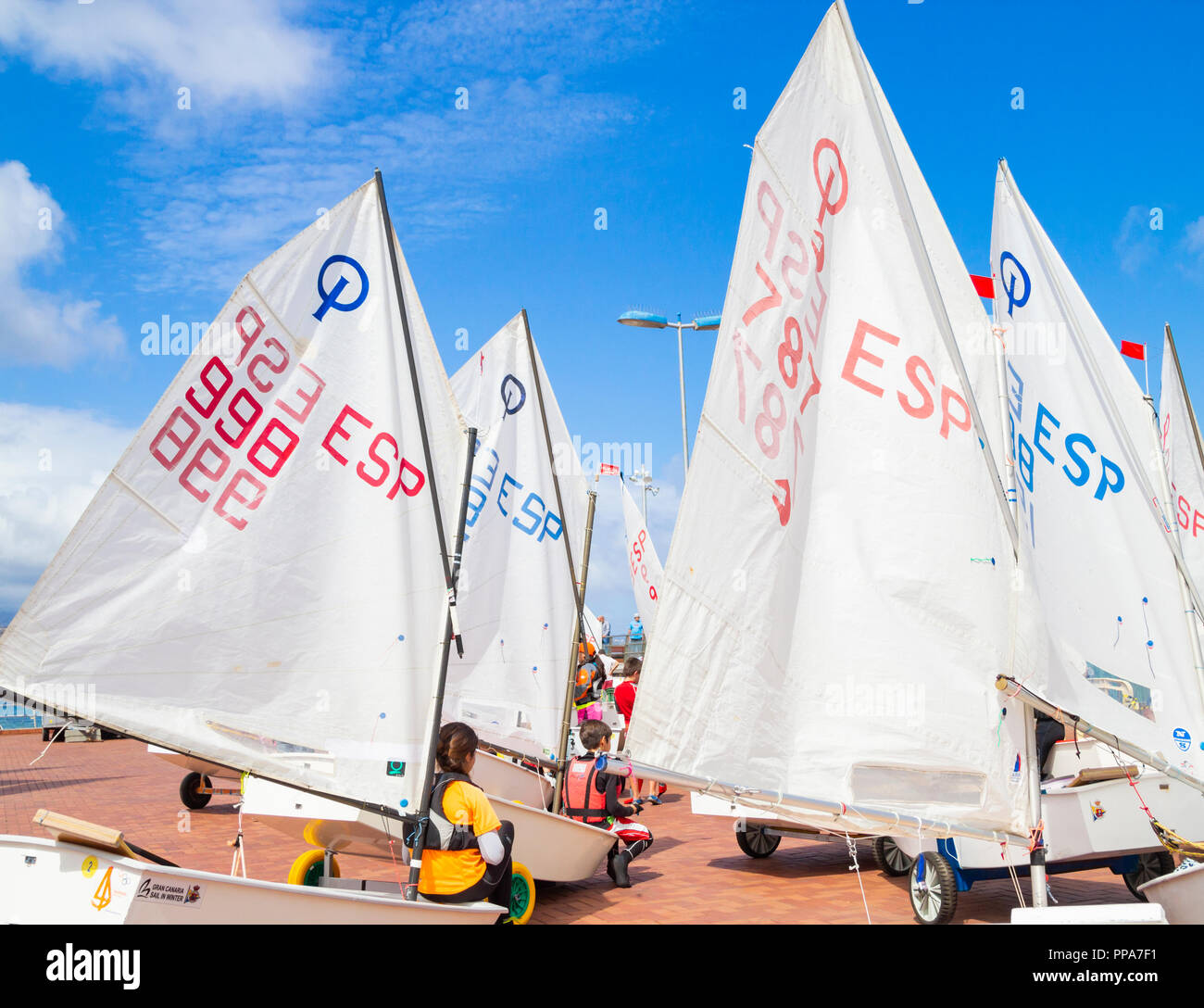 Optimist class dinghies at kids competition in Spain. - Stock Image