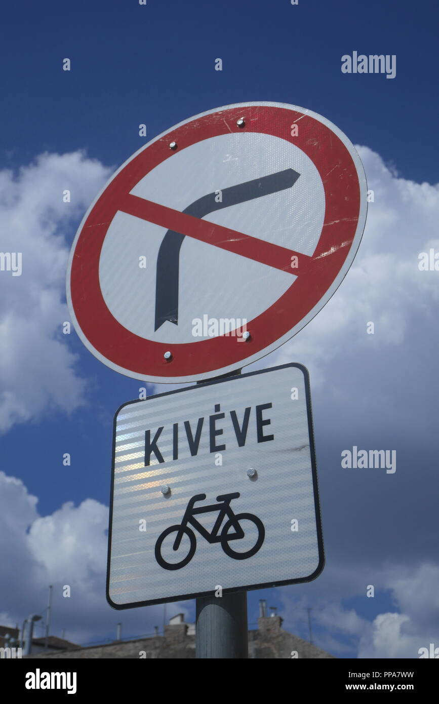 Road signs indicating no right turn and no entry except for cyclists, in Hungarian, Budapest, Hungary - Stock Image