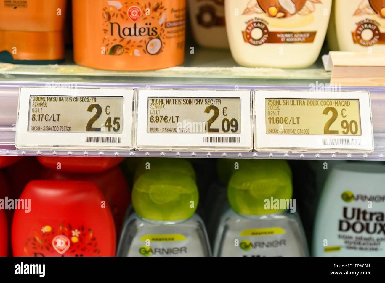 Electronic Shelf Labels on supermarket shelf, France - Stock Image