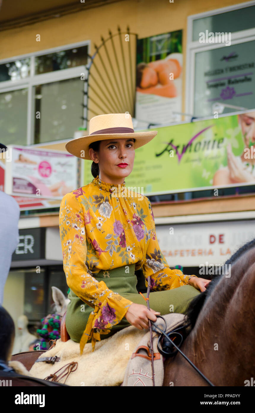 Woman in traditional costume riding horse, celebration, event, Fuengirola, Andalusia, Spain Stock Photo