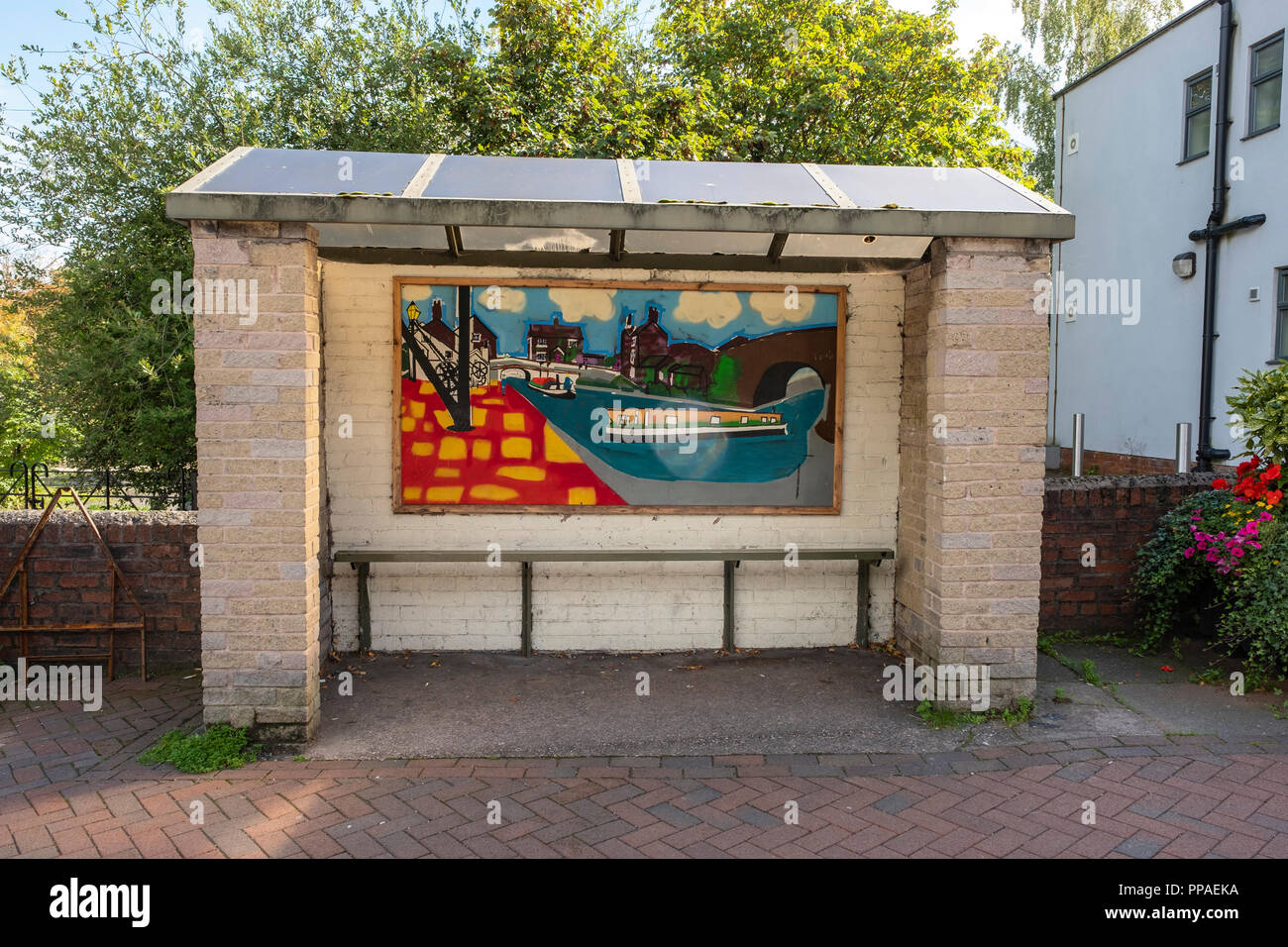 Art inside bus shelter in Middlewich Cheshire UK - Stock Image