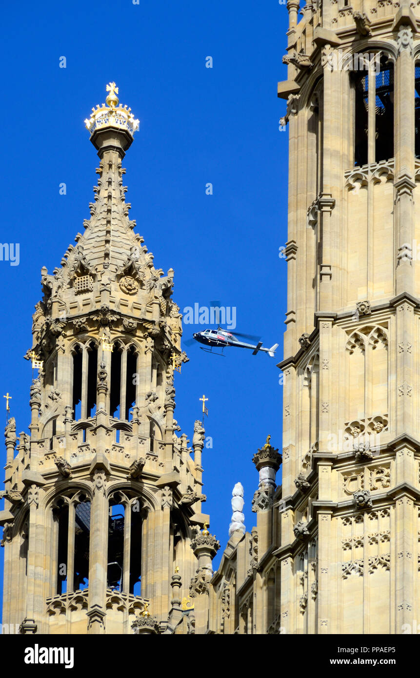 Sky News TV helicopter flying over the Houses of Parliament, Westminster, London, England, UK. - Stock Image