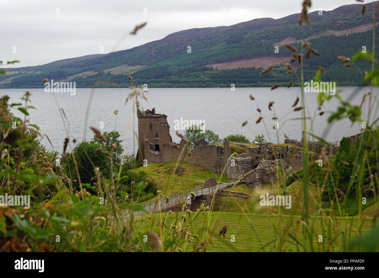 Urquhart Castle is a ruined castle on Loch Ness. The nearest town is Drumnadrochit, which is about 2.7 km away. - Stock Image
