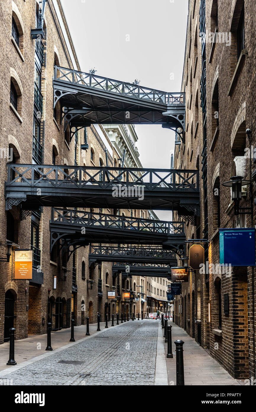 The street Shad Thames and the connecting bridges, Southwark, London, England, UK. - Stock Image