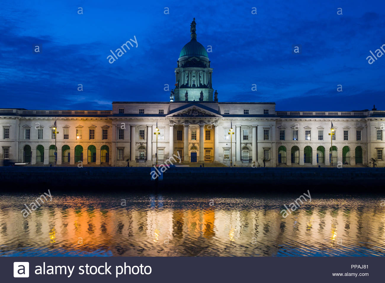 The Custom House at night reflecting in the River Liffey, The building is a masterpiece of European neo-classicism architecture, North Dock, Dublin, L - Stock Image