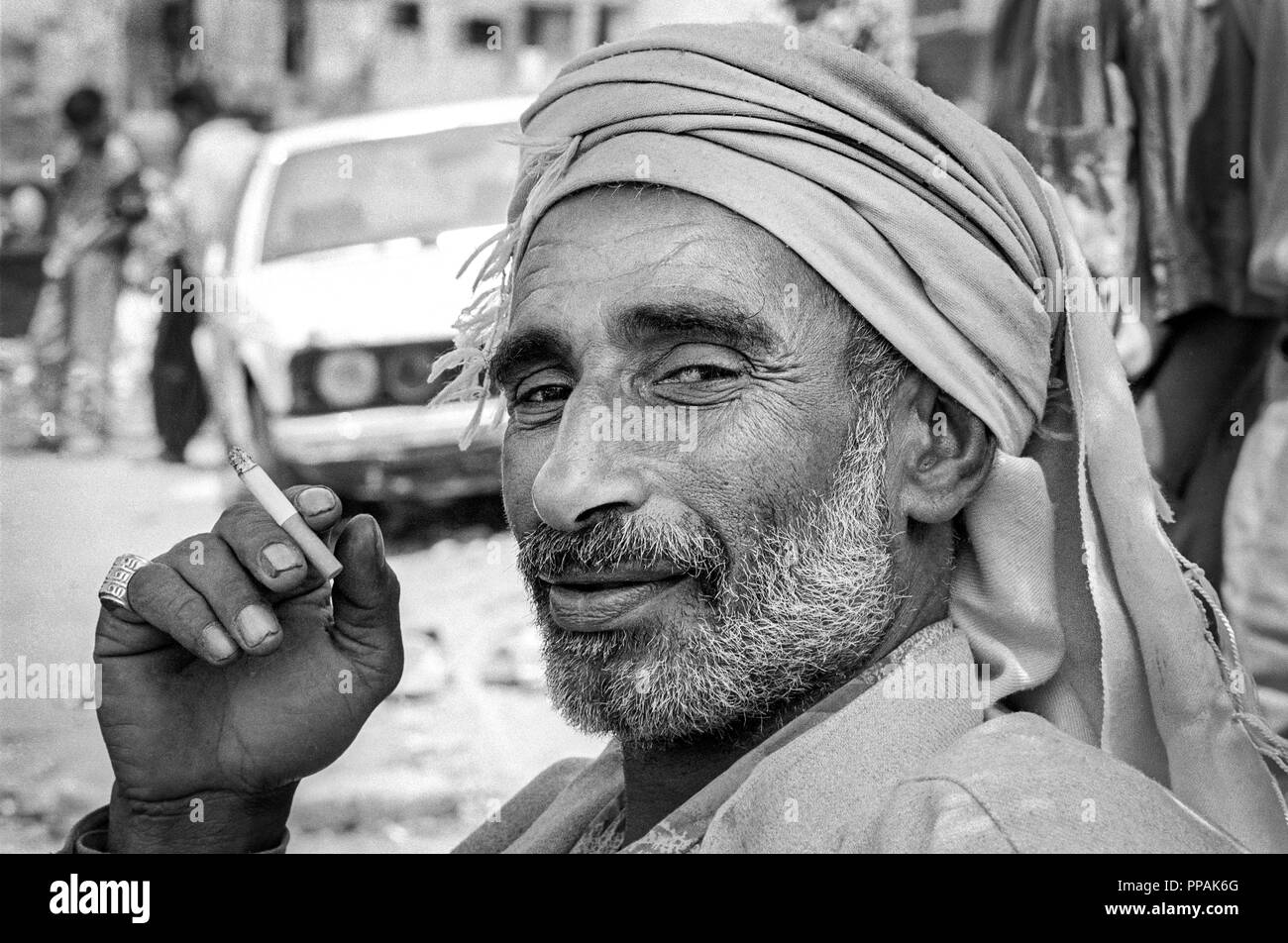 Portrait of a man smoking a cigarette. Palestinian Refugee Camps of Sabra and Shatila, Beirut, Lebanon 1998. - Stock Image