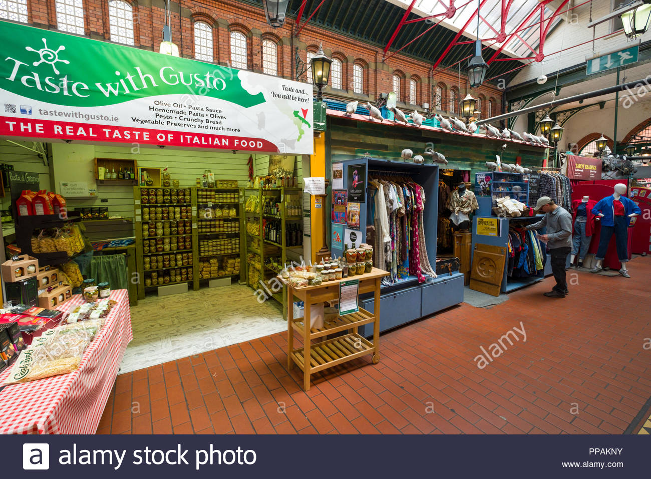 Taste with Gusto and clothing booth inside George's Street Arcade, Dublin, Leinster, Ireland - Stock Image