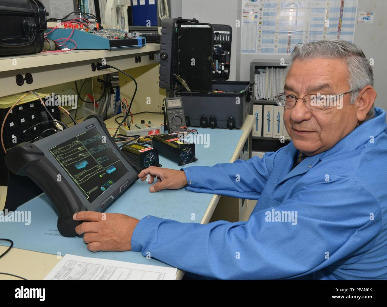 """Electronics Integrated Systems Mechanic Santiago """"Jim"""" Gonzales repairs avionics systems and serviceable items on military helicopters at Tobyhanna's Forward Repair Activity, Corpus Christi Army Depot, Texas. ( - Stock Image"""