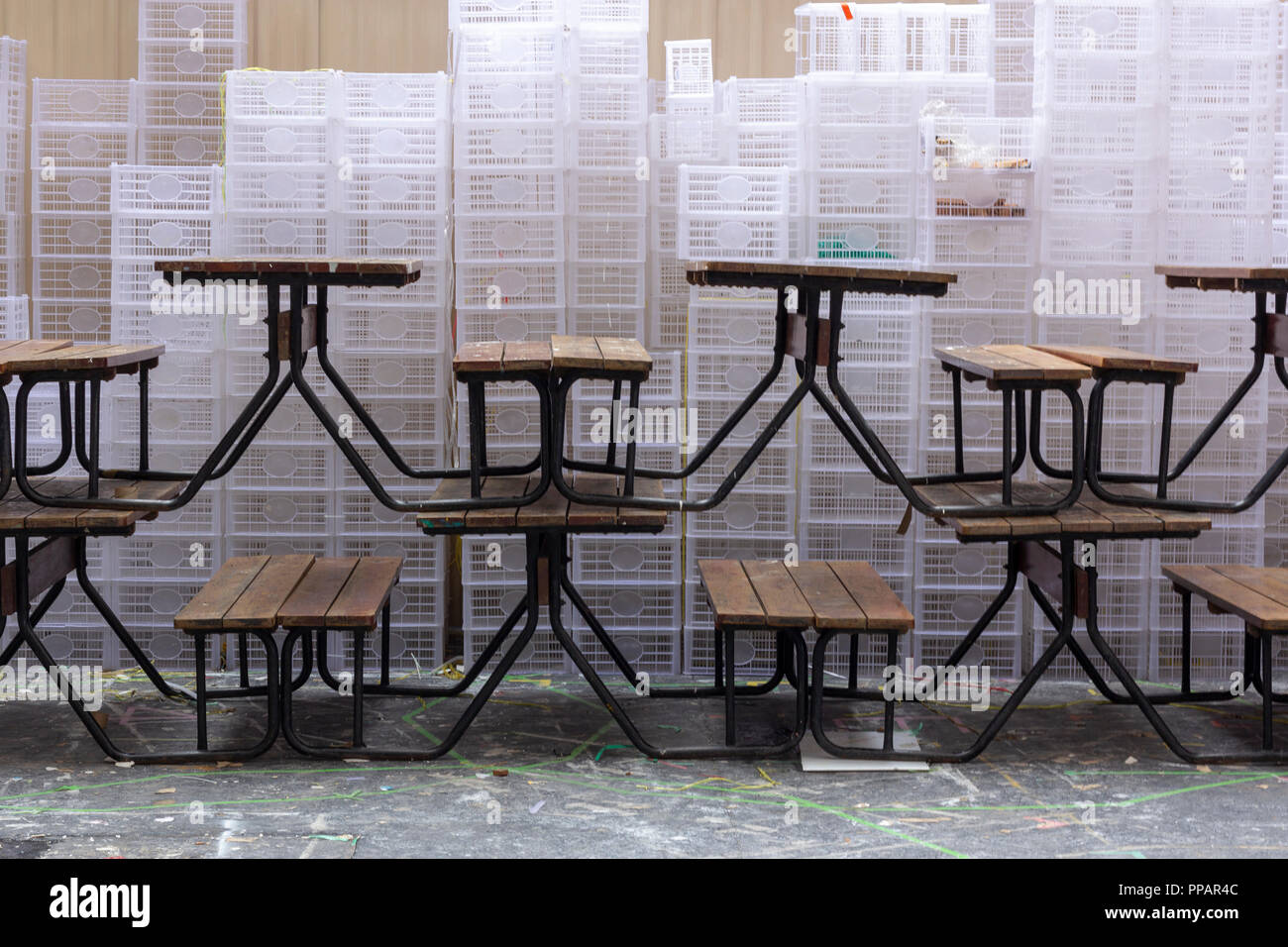 Etonnant Stacked Of Tables And White Plastic Boxes Stock Photo ...