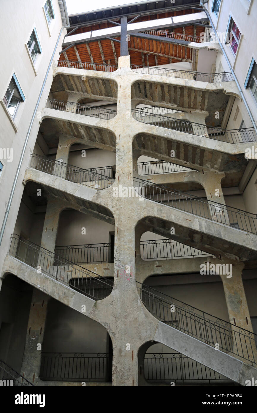 Lyon, France - August 16, 2018: long double stairways called Traboules a typical passageway - Stock Image