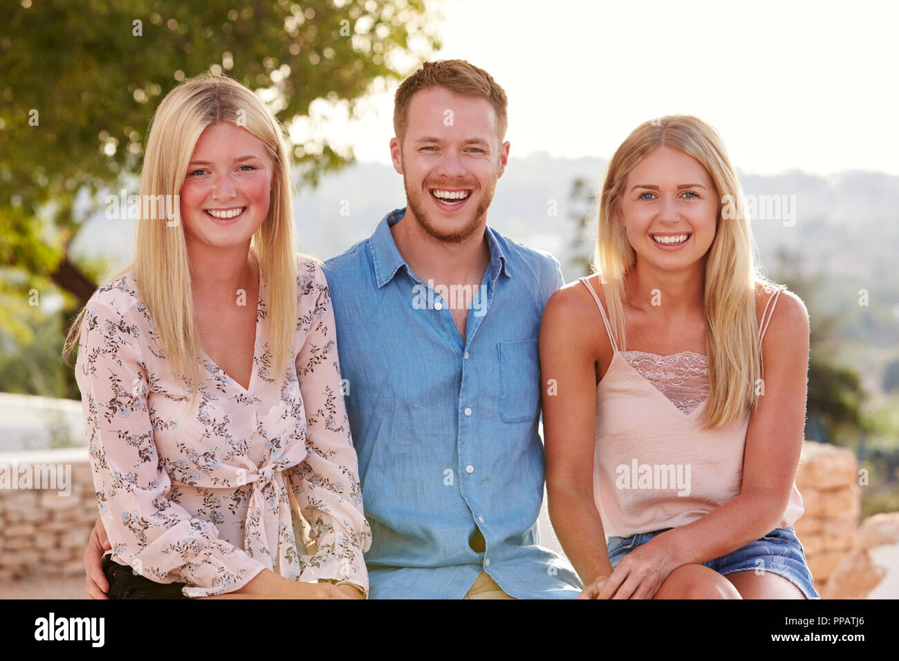 Portrait Of Young Friends Having Fun On Holiday Together - Stock Image