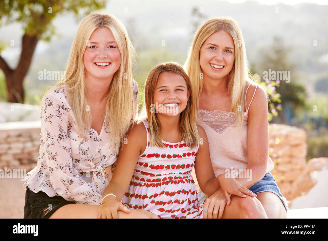 Portrait Of Three Sisters Having Fun On Holiday Together - Stock Image