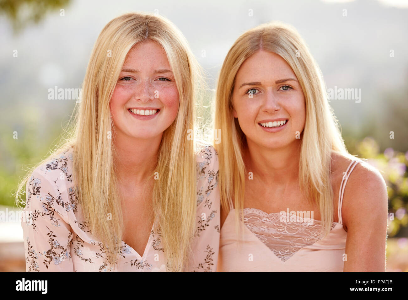 Portrait Of Two Female Friends Having Fun On Holiday Together - Stock Image