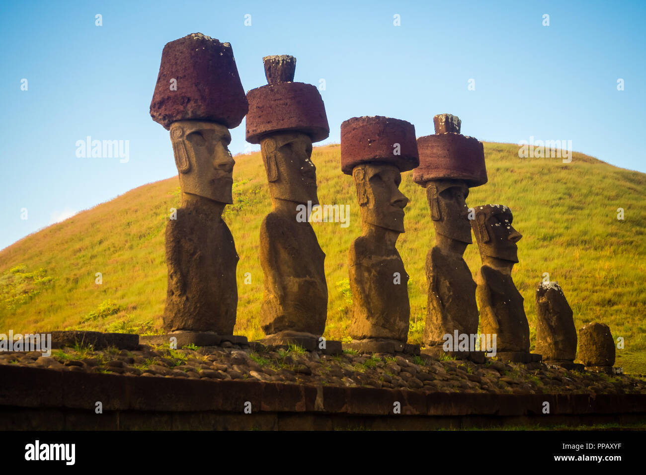 Moais of Ahu Nau Nau in Anakena beach in Easter Island, Chile - Stock Image