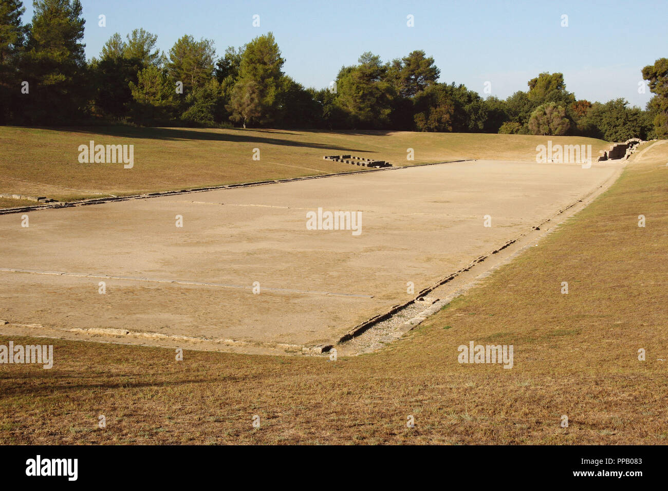 Greek Art. Sanctuary of Olympia. Panorama of the ancient Olympic Stadium. The east of archaelogical site.  Elis. Peloponesse. Greece. Europe. - Stock Image