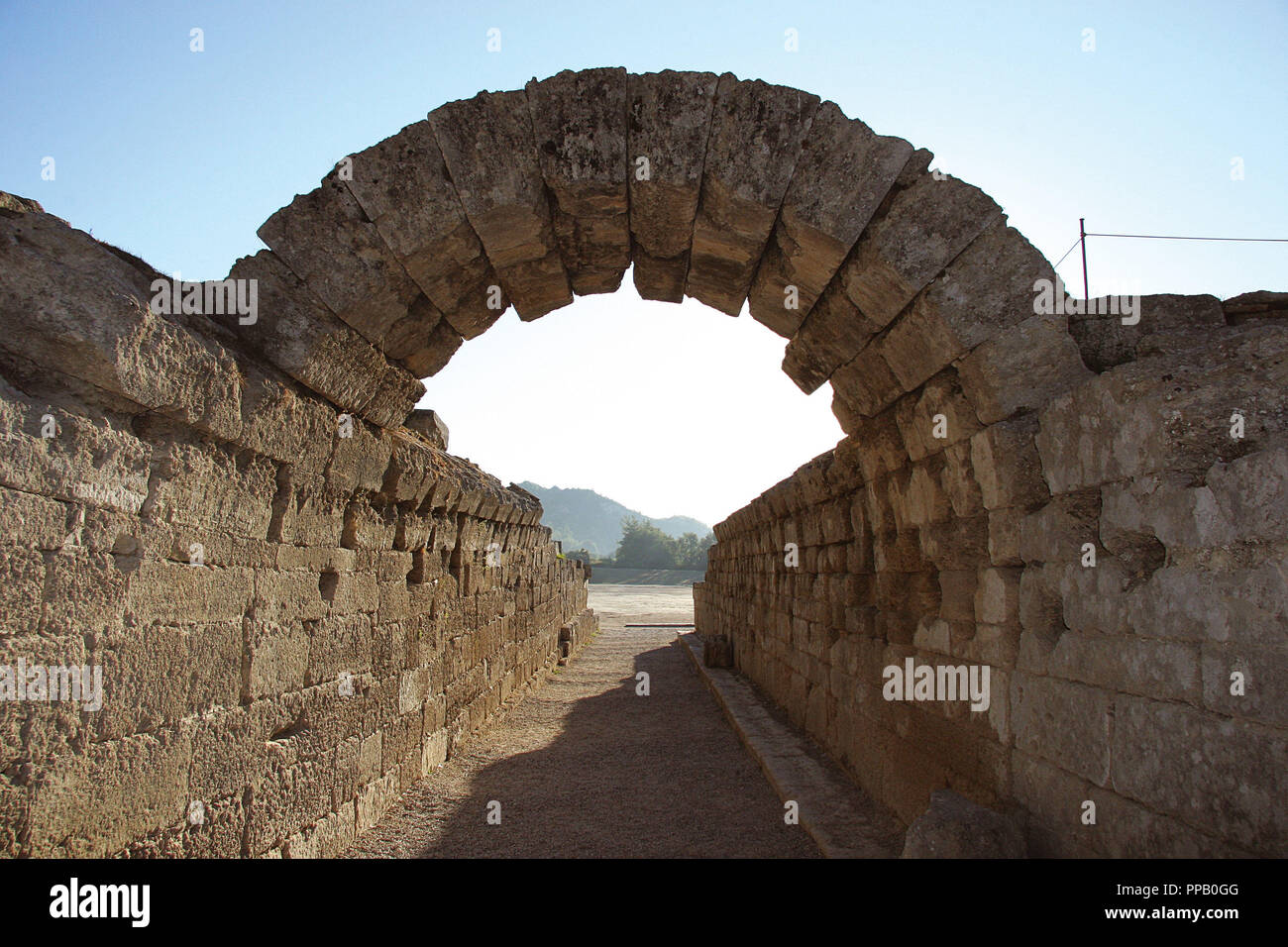 Greek Art. Sanctuary of Olympia. Entrance to olympic stadium. Stone arch. III B.C. The east of archaelogical site.  Elis. Peloponesse. Greece. Europe. - Stock Image