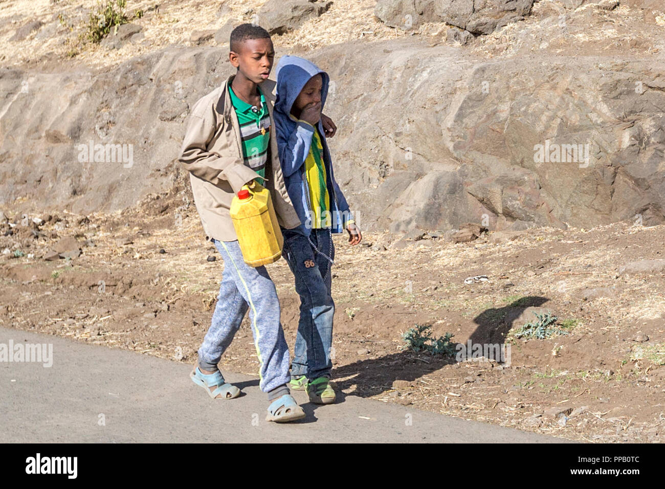 Villages, Amhara Region, Ethiopia, Boys with water in bottle - Stock Image