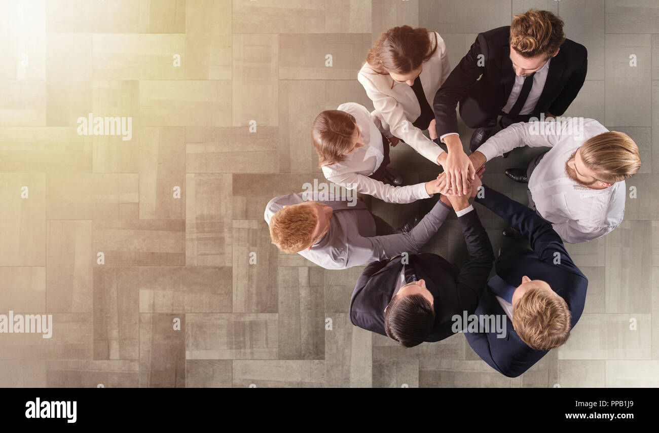 Business people putting their hands together. Concept of integration, teamwork and partnership - Stock Image