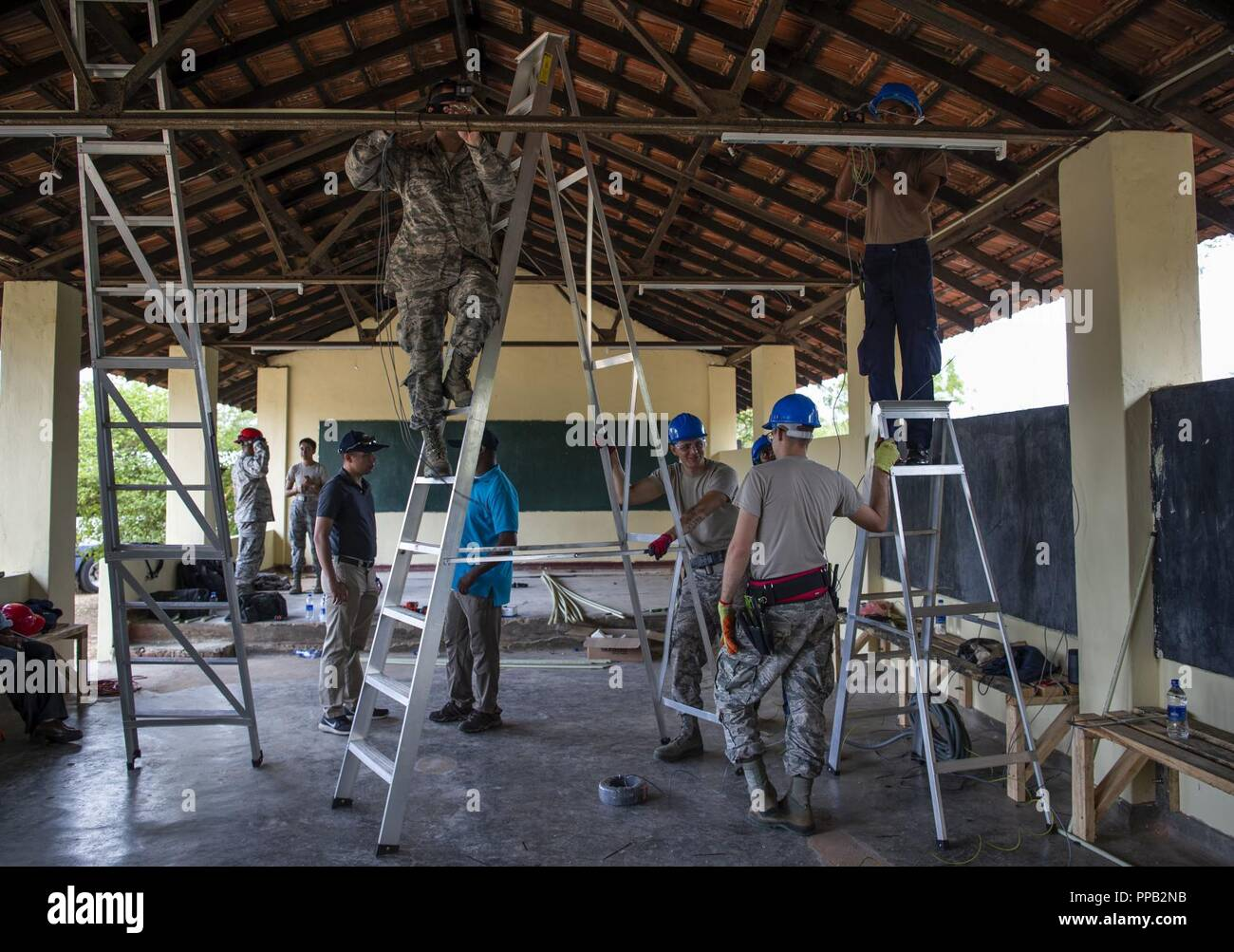 Sri Lanka Air Force Stock Photos Images House Wiring In Us And The Lankan Airmen Install Electrical A School