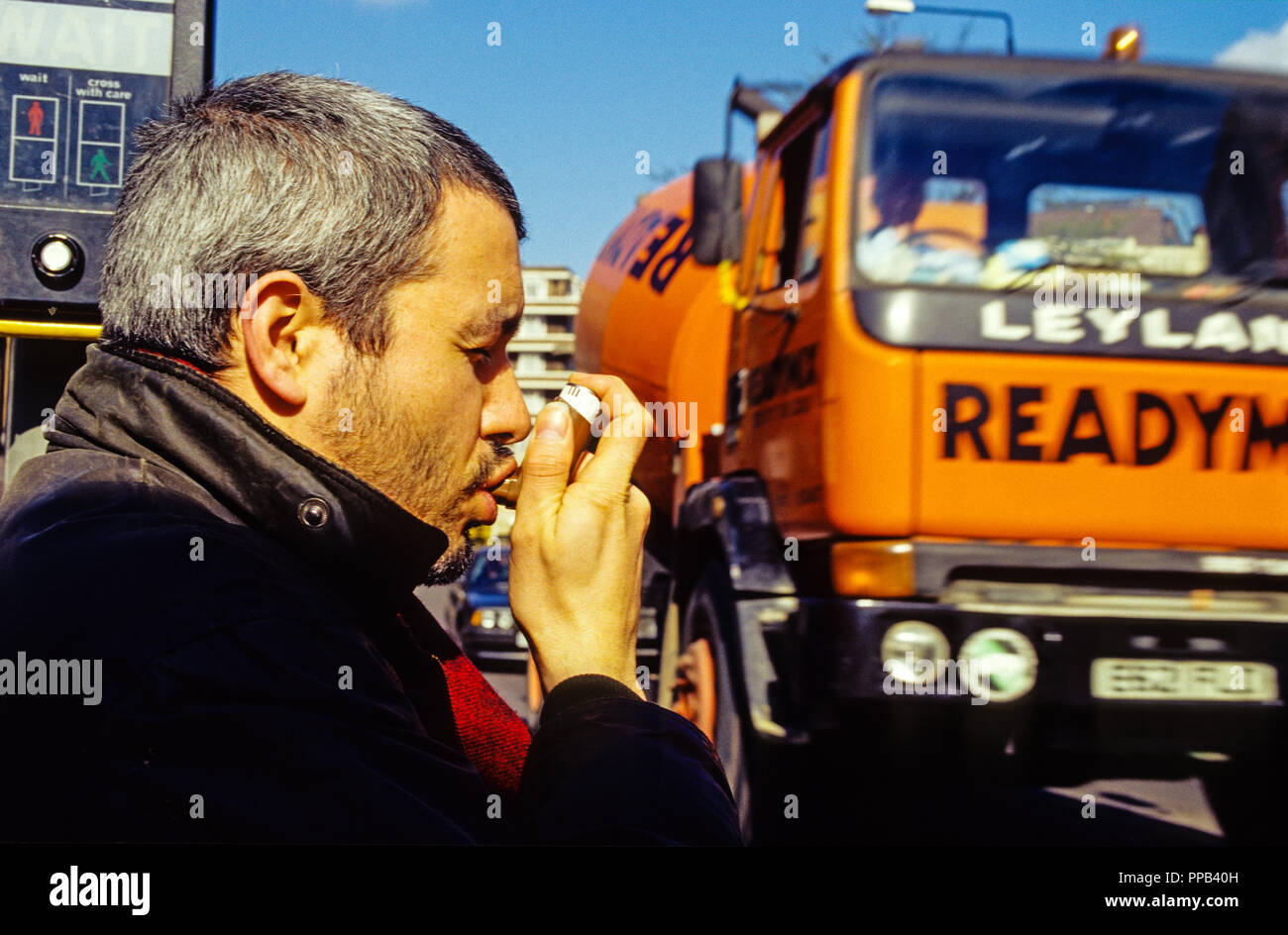 Asthma Suffer, In High Air Pollution Area, Finchley rd, London, England, UK, GB. - Stock Image