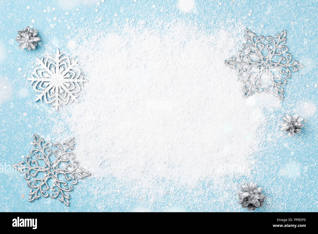 Light blue Christmas frame of snow and silver snowflakes. Winter ...