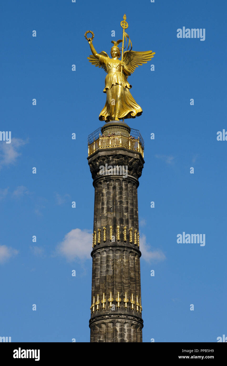 Germany. Berlin Victory Column. Designed by the German architect Heinrich Strack (1805-1880), after 1864. It commemorates the Prussian victory in the Danish-Prussian War although, as the monument was inaugurated in 1873, Prussia has also victorious in the Austro-Prussian War and in the Franco-Prussian War. On the top, is a bronze sculpture of Victoria, designed by the German sculptor Friedrich Drake (1805-1882). Tiergarten Park. - Stock Image
